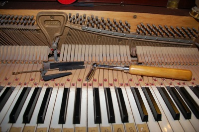 Piano tuning tools on an open piano